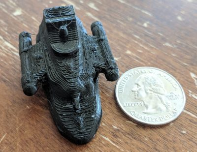 small low resolution print of the model with a quarter for scale comparison